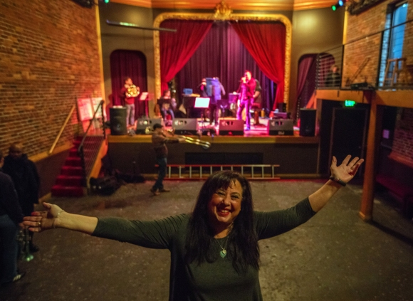 Friday, December 18, 2015.   Lara Lavi is the new co-manager of the Columbia City Theatre in Seattle's Columbia District and has plans to renovate the place.  Musicians are practicing in the backround.